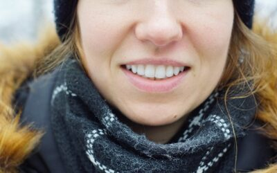 What is the difference between a dental crown and a dental bridge?